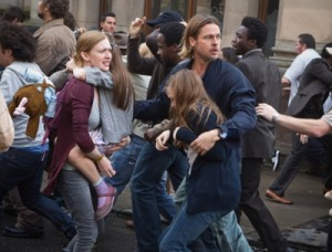 Mireille Enos is Karin (center left), Sterling Jerins is Connie, and Brad Pitt (center right) is Gerald Lane in WORLD WAR Z, from Paramount Pictures and Skydance Productions in association with Hemisphere Media Capital and GK Films. Photo credit: Jaap Buitendijk. (c) 2012 Paramount Pictures. All Rights Reserved.